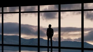 The man standing near panoramic windows on the cloud flow background. time lapse