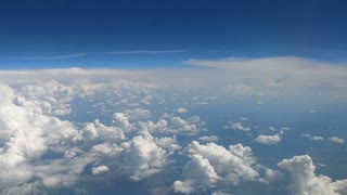 The airplane flighting above the land. time lapse