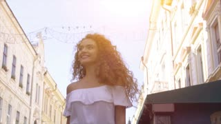 The attractive woman walking outdoor. slow motion