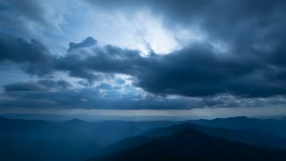 The beautiful cloud stream above mountains. time lapse