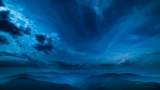 The beautiful mountain landscape on a cloud stream background. night time