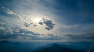 The beautiful mountain landscape on a sunset background. time lapse
