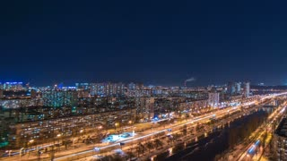 The beautiful night cityscape with a river. time lapse