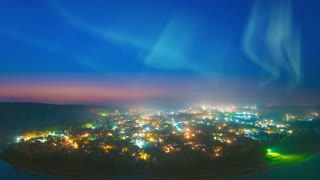The beautiful northern light over the night city. time lapse