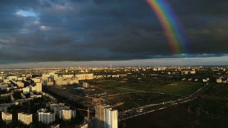 The beautiful rainbow on the cityscape background. quadrocopter shot