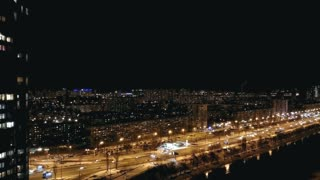 The beautiful view on the night city with a traffic. time lapse