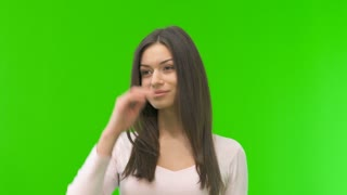 The beautiful woman stand on the green screen background