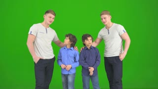 The brothers gesture on the green background