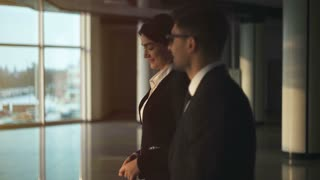 The business couple walking in the office. slow motion