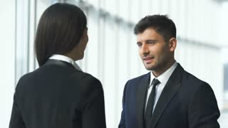 The business man and a woman talking in the office center