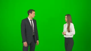 The business man and woman touch the virtual screen on the green background