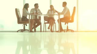 The business partners discuss at the table