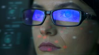 The businesswoman with a glasses look to the virtual display