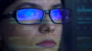 The businesswoman with a glasses look to the virtual screen