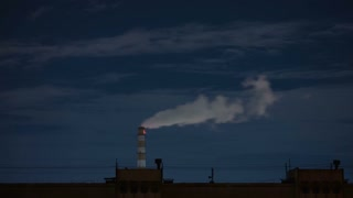 The chimney on a night cloud stream background. time lapse