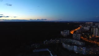 The flight above the city. evening night time, quadrocopter shot