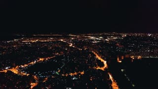 The flight above the city landscape. evening nigth time, quadrocopter shot
