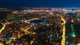 The flight above the night city. time lapse, quadrocopter shot