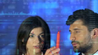 The man and woman draw on the virtual screen. camera motion