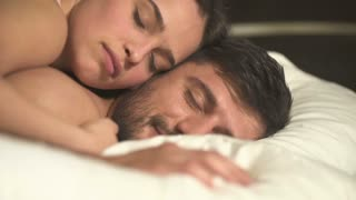 The man and woman lay on the bed. close up