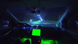 The man drive a car in the autobahn. evening night time. wide angle. green screen display, real time capture