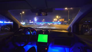 The man drive a car in the city highway. Inside view. evening night view, green screen display, real time capture