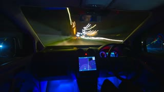 The man drive a car in the evening city. Inside view. Hyperlapse. Wide angle