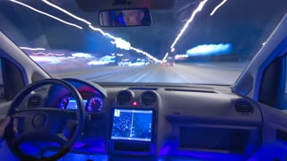 The man drive a car in the night city. Inside view. Hyperlapse