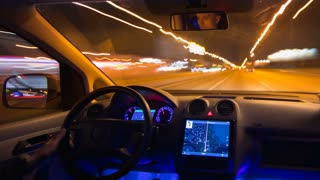 The man drive a car in the night highway. Inside view. Hyperlapse