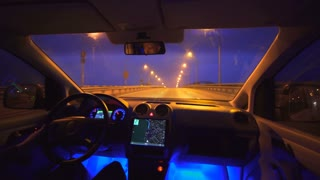 The man drive a car on the evening bridge. inside view. wide angle, real time capture