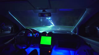 The man drive a car on the night autobahn. inside view. wide angle, alpha channel green screen, real time capture