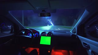 The man drive a car on the night autobahn. inside view. wide angle, green screen display, real time capture