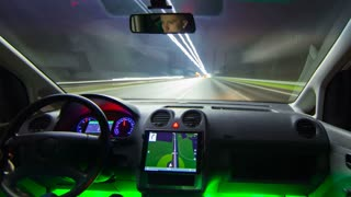 The man drive a car on the night highway. Inside view. Hyperlapse