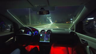The man drive a car on the night highway. inside view. wide angle, real time capture