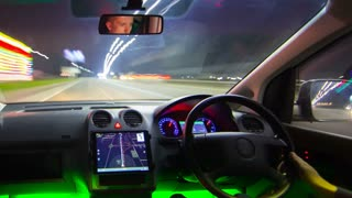 The man drive a car on the night road. Inside view. Hyperlapse