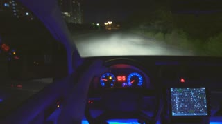 The man drive a car on the road. night time