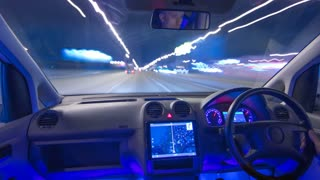 The man drive a vehicle with the gps. Night time. Hyperlapse