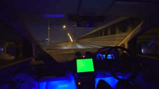 The man drive on the overpass. inside view. left side traffic, alpha channel green screen on the panel, real time capture