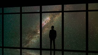 The man standing near windows on the meteor shower background. time lapse