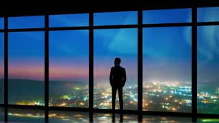 The man standing near windows on the night city background. time lapse