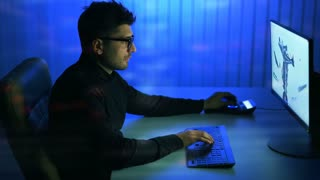 The man working with a 3d modeling over the virtual glass. evening night time