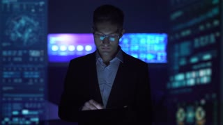 The man working with a tablet in the futuristic office