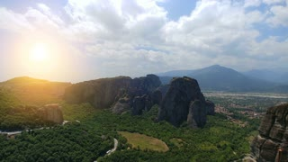 The panoramic mountain landscape on a sunny background, time lapse