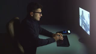 The person working with a 3d manipulator in a computer. night time