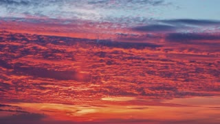 The picturesque red colorful sunset or sunrise with fine texture clouds