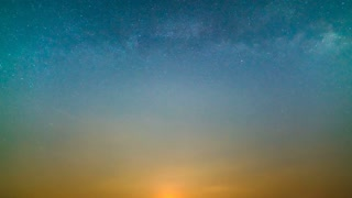 The picturesque sunset on the background of the starry sky. time lapse