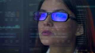 The serious businesswoman look to the virtual screen