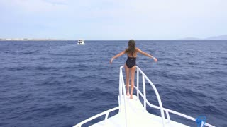 The sexy woman pose on the yacht. Wide angle