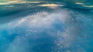 The stream of clouds in the sky. wide angle. plane view