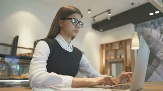 The stressed woman working with a modern laptop at the desktop